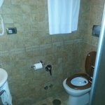 bath with retrofit toilet cover that slipped off when you sat down!