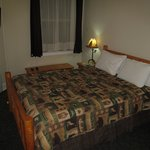 The Cariboo Inn  room with bed