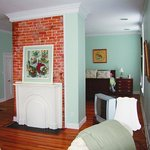 Queen-size bed behind fireplace divider