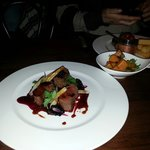 Venison with salsify and bkackberries. Order of pumpkin and a ribeye steak in the background.