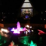 hotel courtyard at night with beautiful fountain.