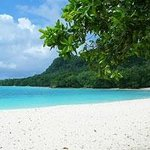 Turquoise waters and soft white sand.