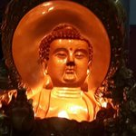 3d carved buddha statue with eyes which move as you move