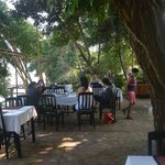 open air breakfast area across the hotel along Mekong River