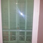 Room windows with double glazing and shutters