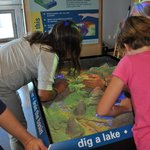 ECHO guests learn about water behavior by manipulating sand in the 3D watershed table.