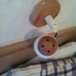 broken, dangerous lamp above bed