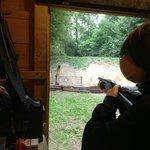 Shooting a 10-gauge shotgun.