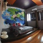 Double bedroom with Lotus wall art