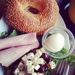 Delicious. Bagel with cream cheese and ham. And a side if olives, feta salad.