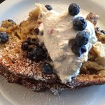 blueberry creme brulee french toast with vanilla infused whipped cream