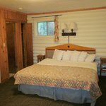 King-size bed; comfy and lots of pillows; bathroom to left