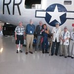 WW II 22nd Bomb Group vets by B24 with Rosie the Riveter