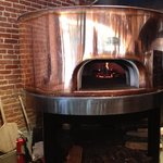 Beautiful copper wood burning pizza oven at Roma's