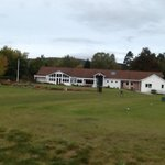 View of clubhouse and first tee
