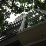 Standing on Hang Hanh St, looking up at the balconies of Silver Moon