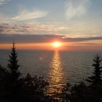 "Sunrise over Lake Superior from our deck at our Cove ""cottage""."