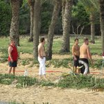 The manager (only one in trousers!) joins in the volleyball game