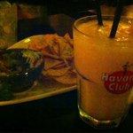 Nachos and guacamole. Mangolococo and Caipirinha.