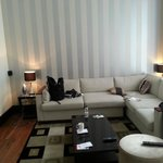 1 Bedroom Deluxe Living area with big Flat Screen and dining table