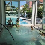 A view from the indoor Jacuzzi to the outdoor pool