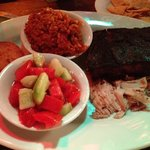 Two meat platter--ribs & smoked turkey.  Tomato-cuke salad and red rice.