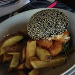 Red snapper burger; chili ailoi, agria chips - bun colored with squid ink!