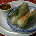 Giant spring rolls with delicious peanut sauce.