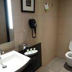 Room to move around toilet.