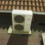 Window opens onto AC units.