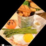 Home-cooked Honey Glazed Roast Ham with a Fried Ducks Egg, Hand-cut Chips, Local Asparagus, and