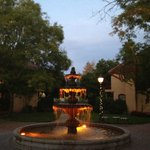Night lit fountain in courtyard