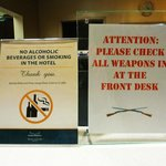 Signs at the front desk. No booze, no guns.