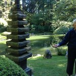 The tour guide from Friends of the Garden explains the different shrines