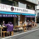 オープンエアの鮮魚料理店