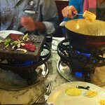 Hot stone and cheese fondue