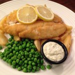 Breaded haddock with handcut chips and peas