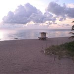 Early morning beach view with lifeguard area nearby
