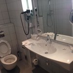 immaculate bathroom with seperate tub and two shower heads