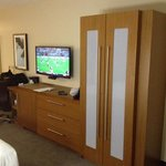 TV, clothes storage, desk