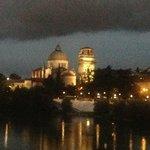 Night view from Ponte Pietra bridge across from Santo Stefano