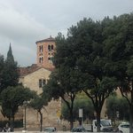 Santo Stefano behind the trees
