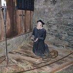 Clergyman prisoner prays for his sins...
