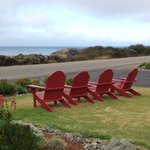Adirondack chairs on the lawn for amazing view