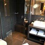 Modern, renovated bathroom with rain showerhead
