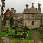 View of the back of Muckross House with gardens