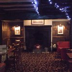 one of the many lounges with open log fire