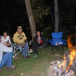 Telling tall tales at the campfire by the cabins