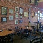 True cafe atmosphere.  Local art decorates original brick wall
