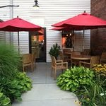 Outdoor seating in the rear with municiple parking available.